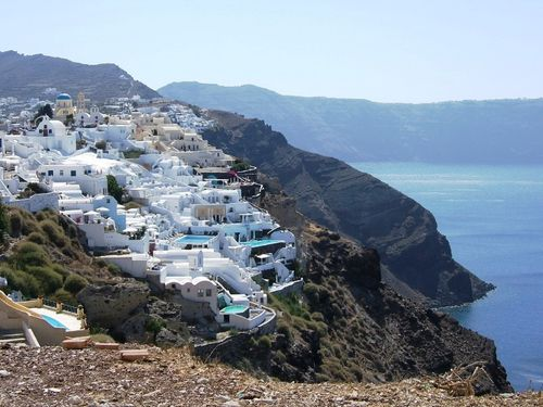 White houses of Oia carved into the cliff
