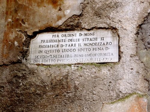 Old Roman Sign in Stone Wall